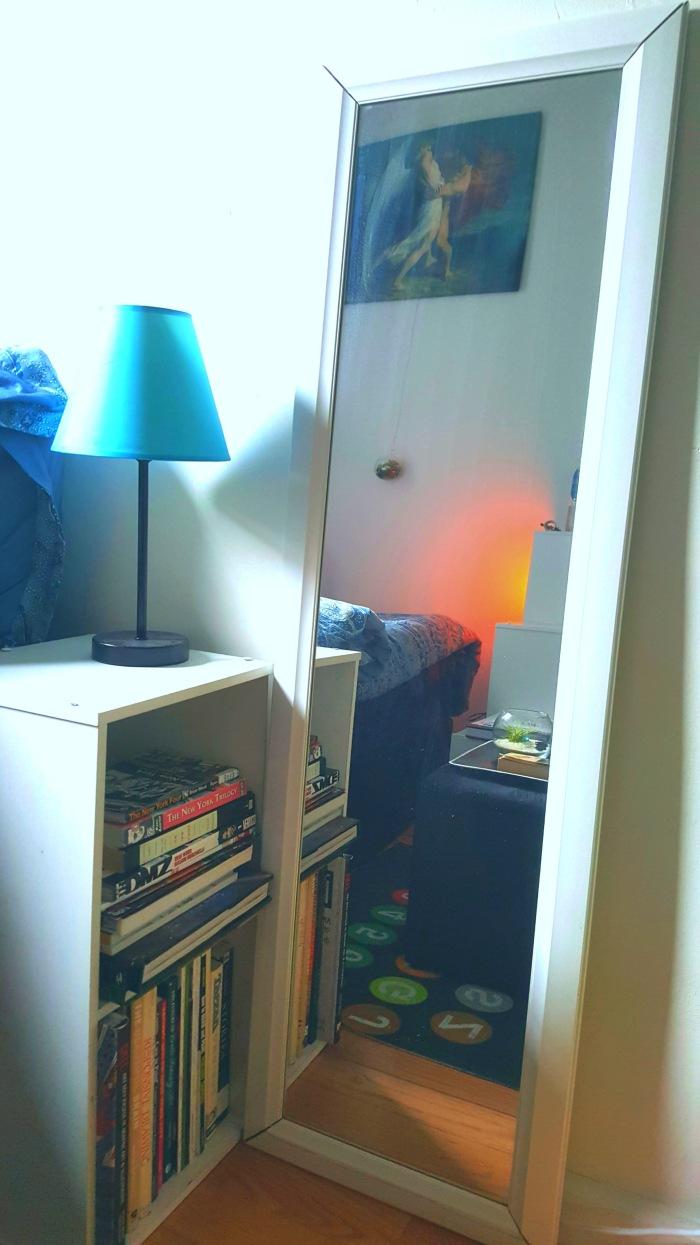 Mirror and bookshelf with nightlamp